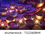 singing bowls lit by candlelight | Shutterstock . vector #712260844