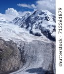 Small photo of Monte Rosa, landscape of alpine glacier in swiss Alps at SWITZERLAND from Gornergrat near Zermatt village, cloudy blue sky in 2017 warm sunny summer day - vertical, Europe on July.