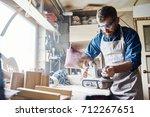 confident bearded carpenter... | Shutterstock . vector #712267651