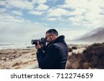 side view shot of young... | Shutterstock . vector #712274659