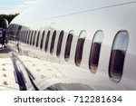windows on airplane... | Shutterstock . vector #712281634