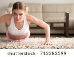 young sporty woman doing push... | Shutterstock . vector #712283599