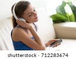 relaxed calm young woman enjoys ...   Shutterstock . vector #712283674