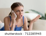 angry young woman arguing... | Shutterstock . vector #712285945