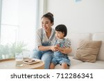 cute little girl and her... | Shutterstock . vector #712286341
