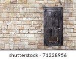 Old Wooden Door On Grunge Bric...