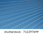 cables over the blue sky | Shutterstock . vector #712297699