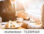 unrecognizable business... | Shutterstock . vector #712309165