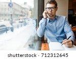 young jobless man making...   Shutterstock . vector #712312645