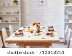 six chairs around festive table ...   Shutterstock . vector #712313251