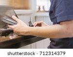 technician using a computer fix ...   Shutterstock . vector #712314379