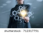 business hand holding light... | Shutterstock . vector #712317751