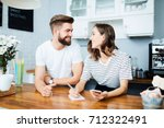 couple of joyful young new... | Shutterstock . vector #712322491
