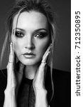 fashion studio portrait of...   Shutterstock . vector #712350895
