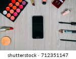 top view of cosmetics and make... | Shutterstock . vector #712351147