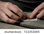 Rolling a cigarette - stock photo