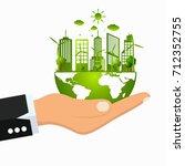 hand green ecology city... | Shutterstock .eps vector #712352755
