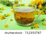 a cup of herbal hypericum tea... | Shutterstock . vector #712353787