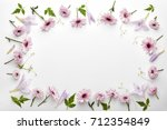 frame made of flowers and... | Shutterstock . vector #712354849
