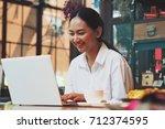 asian woman working in coffee