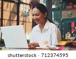 asian woman working in coffee... | Shutterstock . vector #712374595