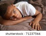 depressed teenage boy lying in... | Shutterstock . vector #71237566