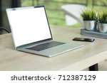 laptop blank screen on work... | Shutterstock . vector #712387129