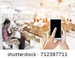 man use mobile phone   blur... | Shutterstock . vector #712387711