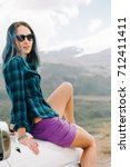 explorer young woman sitting on ... | Shutterstock . vector #712411411