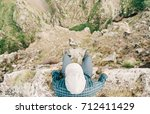 explorer young man sitting on... | Shutterstock . vector #712411429
