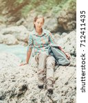 explorer young woman wearing in ... | Shutterstock . vector #712411435