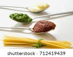 spaghetti and three spoons with ... | Shutterstock . vector #712419439