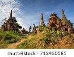 visiting the nyaung oak pagoda... | Shutterstock . vector #712420585