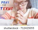 women praying  pray for texus | Shutterstock . vector #712425055