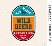 wild deers badge  colored... | Shutterstock .eps vector #712429699