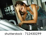 woman on the treadmill with... | Shutterstock . vector #712430299