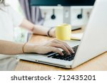 young asian girl is freelancer... | Shutterstock . vector #712435201