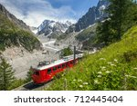 A Red Train In European Alps ...