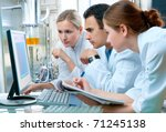 group of scientists working at... | Shutterstock . vector #71245138