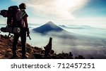 rear view of traveler guy with... | Shutterstock . vector #712457251