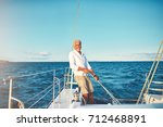 smiling mature man standing on... | Shutterstock . vector #712468891