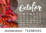 bright red autumn leaves and... | Shutterstock . vector #712484101
