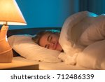 the smile woman sleeping on the ... | Shutterstock . vector #712486339