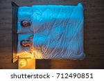 the couple sleeping on the bed. ... | Shutterstock . vector #712490851