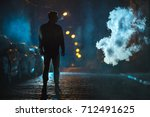 the man smoke in the cloud of... | Shutterstock . vector #712491625