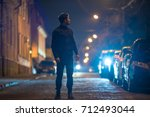 the man stand on the road.... | Shutterstock . vector #712493044