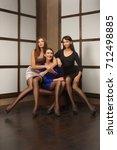 three girls in fitting dress in ... | Shutterstock . vector #712498885