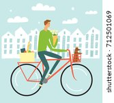 man riding on a bicycle with... | Shutterstock .eps vector #712501069