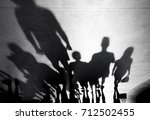 blurry shadows silhouette of... | Shutterstock . vector #712502455