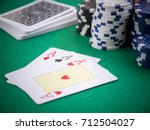Three Poker Aces On Table With...